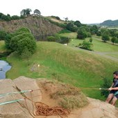 Man abseiling down quarry side