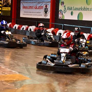 Colleagues at Mackinnon & Co. race for the finish line at ScotKart