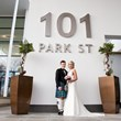 101 Park St bride and groom under sign (2)