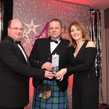 Elphinstone Hotel awarded lanarkshire tourism award from Kaye Adams