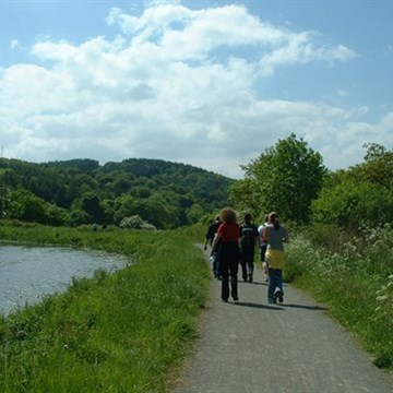 Walkers on canal pathway