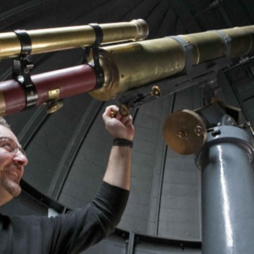 Airdrie Observatory, man looking through telescope